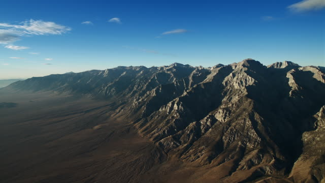 blue sky over owens valley and the sierra escarpment. - basin and range province stock videos and b-roll footage