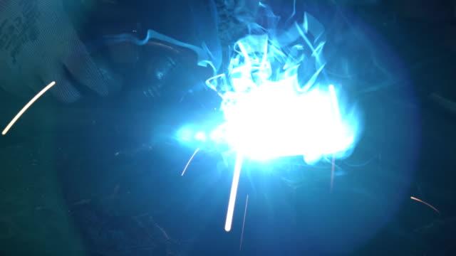 blue sparks of metal welding close-up shot - work helmet stock videos & royalty-free footage