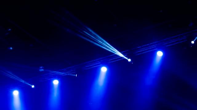 Blue stage spotlights.