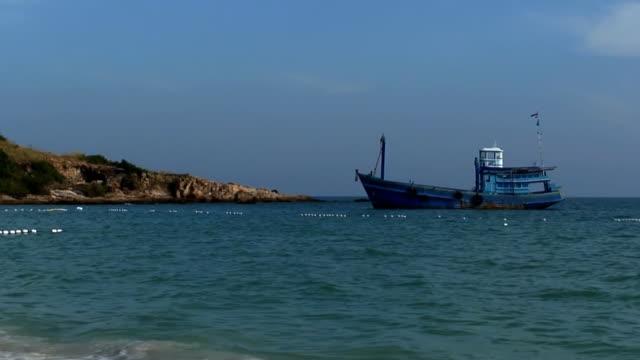 blue thai fishing boat - long shot - anchored stock videos & royalty-free footage