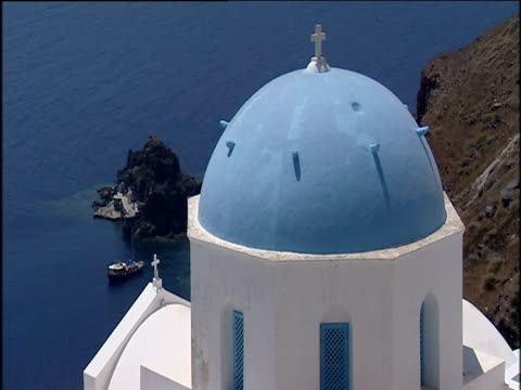 Blue topped whitewash church overlooking the ocean; Greece