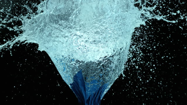 SLO MO blue water filled balloon exploding