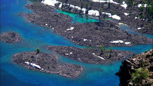 blue waters surround volcanic islands, wizard island, crater lake national park, oregon. - crater lake oregon stock videos & royalty-free footage
