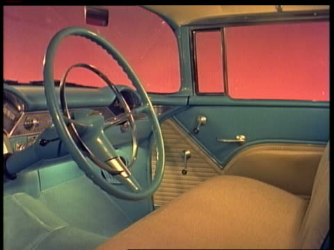 1955 blue + white front seat, steering wheel + dashboard in Chevrolet / pink background
