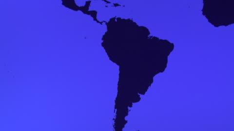 ms, tu, blue world map showing americas - latin america stock videos & royalty-free footage