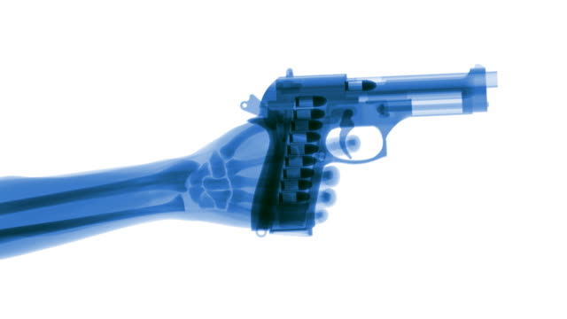 stockvideo's en b-roll-footage met blue x-ray hand firing gun in slow motion - pistool handwapen