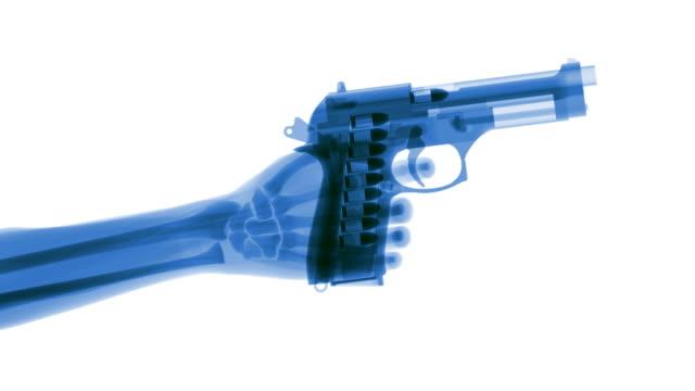 blue x-ray hand firing gun - skjutvapen bildbanksvideor och videomaterial från bakom kulisserna