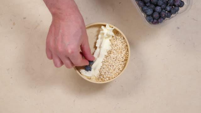 blueberries on kefir beverage. - oatmeal stock videos & royalty-free footage