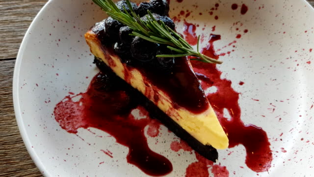 blueberry cheese cake with serving and cutting cake - blueberry muffin stock videos & royalty-free footage