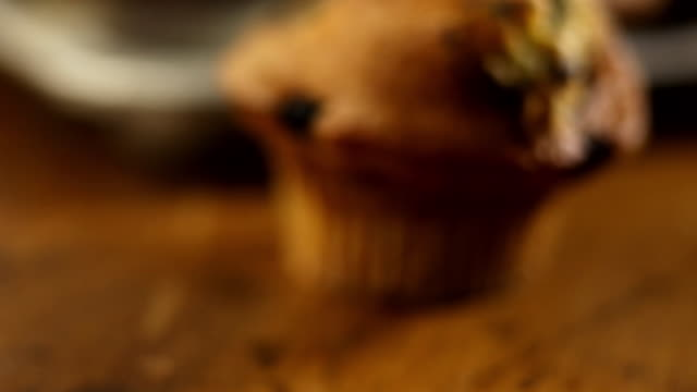 a blueberry muffin is on a table. - blueberry muffin stock videos & royalty-free footage