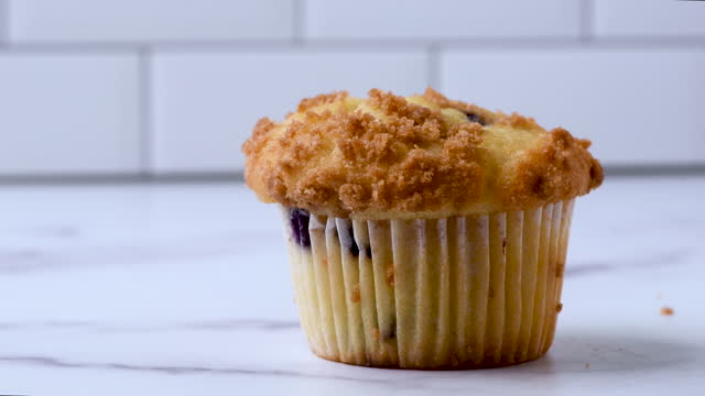 blueberry muffin over a kitchen counter - blueberry muffin stock videos & royalty-free footage