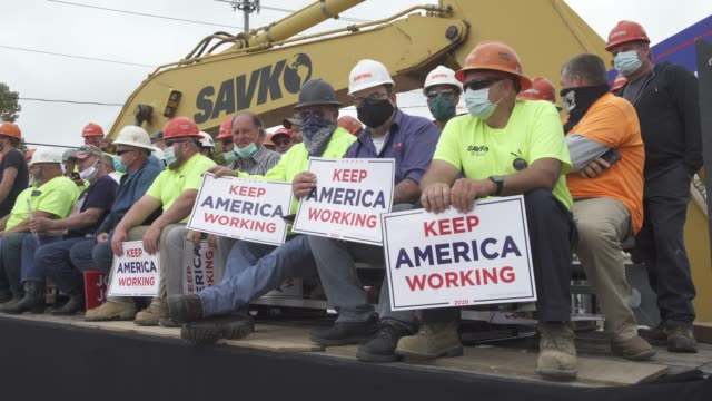 blue-collar construction workers of nickolas savko & sons hold signs in support of president donald trump's economic plans during a campaign event on... - manual worker stock videos & royalty-free footage