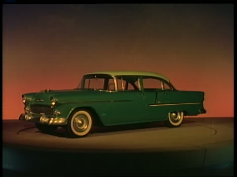 1955 blue/green chevrolet bel air on display on spinning platform in showroom - chevrolet stock videos & royalty-free footage