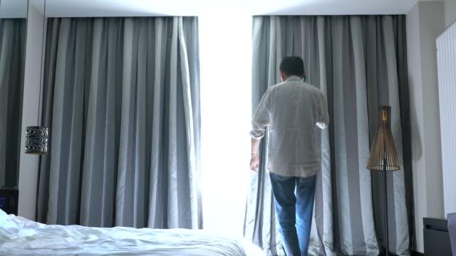 bluetooth curtain in a smart hotel - intelligenz stock-videos und b-roll-filmmaterial