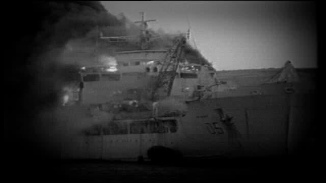 25th anniversary task force family support lib islands bluff cove ext graphicised sequence sir galahad british navy ship on fire during falklands war - baia video stock e b–roll