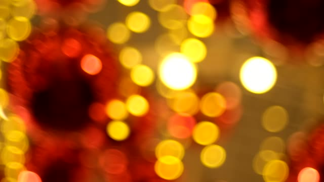 blur abstract red and orange bokeh light background in christmas decoration fair holiday vacation - competition round stock videos and b-roll footage