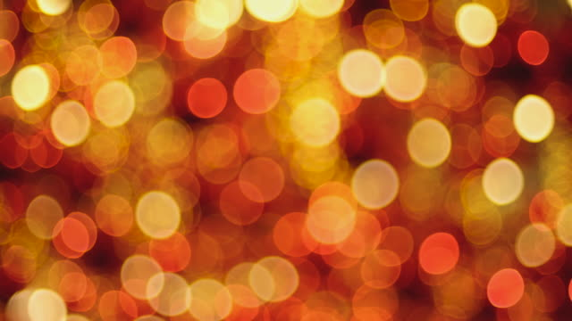 blur abstract red and orange bokeh light background in christmas decoration fair holiday vacation - orange colour background stock videos & royalty-free footage