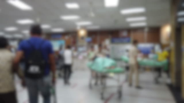 blur background of medical personnel and patient in hospital - lobby stock videos & royalty-free footage