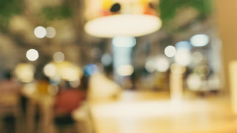 blur background of people dinning in cafe restaurant with big lamp with bokeh light, - breakfast stock videos & royalty-free footage
