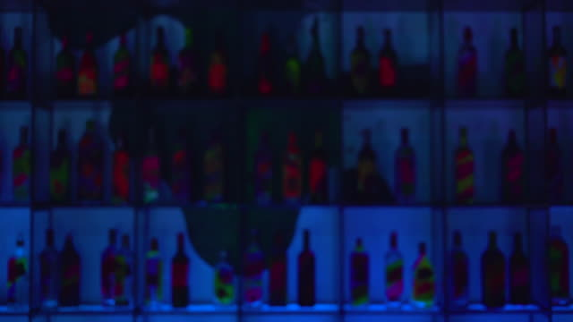 blur background of various alcohol bottles in a bar - bar background stock videos & royalty-free footage