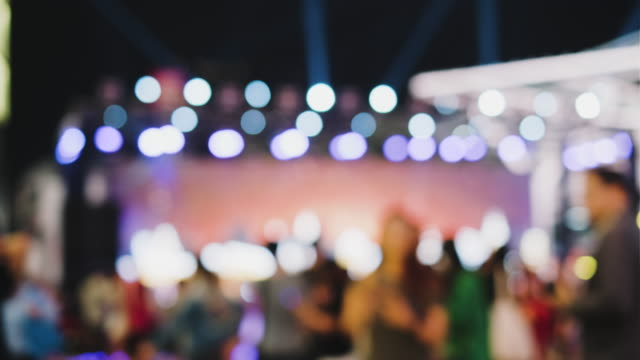 blur crowd of people at event concert lighting and sound with bokeh light background - bar background stock videos & royalty-free footage