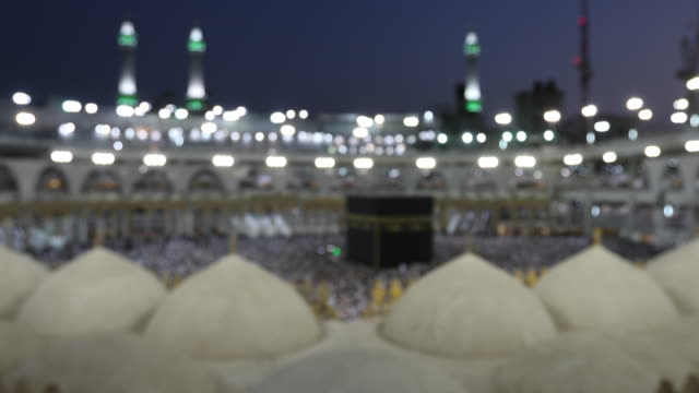 blur for background group of islamic during prayer in mecca saudi arabia - mecca stock videos and b-roll footage