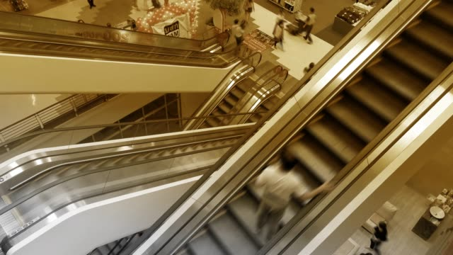 blur group view of people taking white escalators in chiang mai, thailand - escalator stock videos & royalty-free footage