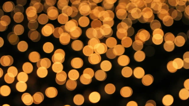 blur of candle light at night - oro video stock e b–roll