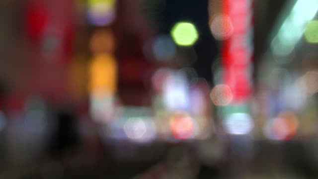 blur of shinjuku in the evening - ネオンカラー点の映像素材/bロール