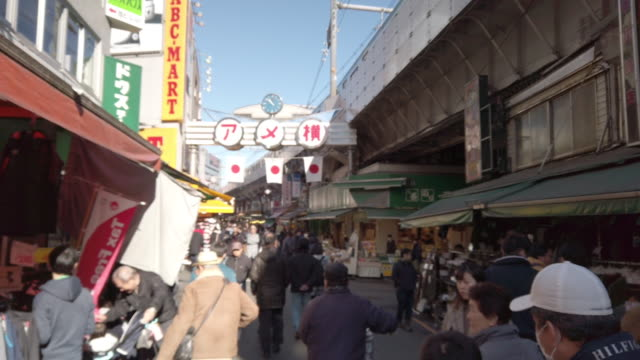 blur . pedestrians crowded shopping at ameyoko market ueno tokyo - flea market stock videos & royalty-free footage