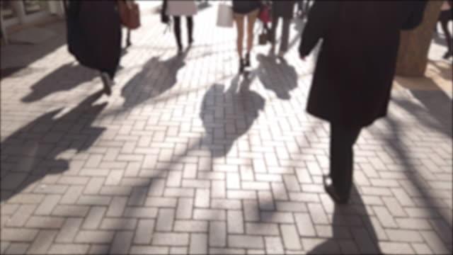 4k blur slow people walking to transport - pedestrian walkway stock videos & royalty-free footage
