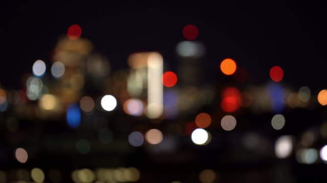 blurred background: boston highway to skyline skyscraper cityscape sunset - defocused stock videos & royalty-free footage