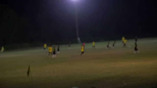 blurred background of a football field - baseball player stock videos & royalty-free footage
