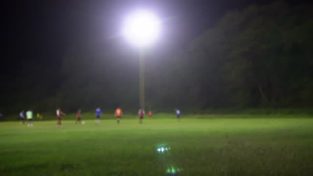 blurred background of a football field - football pitch stock videos & royalty-free footage