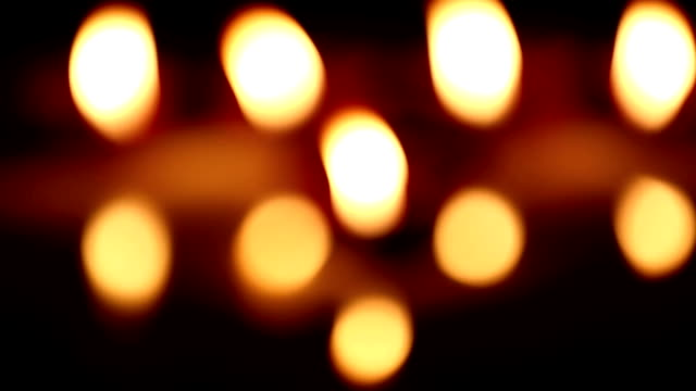 blurred background of oil lamps - oil lamp stock videos & royalty-free footage