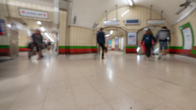 Blurred background of Pedestrian Commuter Crowd at Subway station ticket hall in London England UK