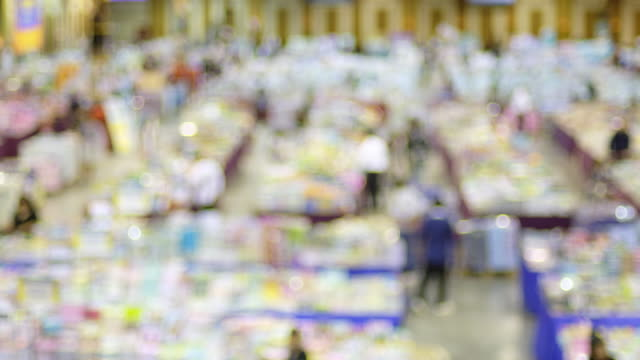 blurred background of people shopping at event trade market fair festival in convention hall. - tradeshow stock videos and b-roll footage