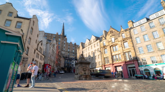 blurred background time-lapse: grass market edinburgh old town in scotland uk - edinburgh scotland stock videos & royalty-free footage