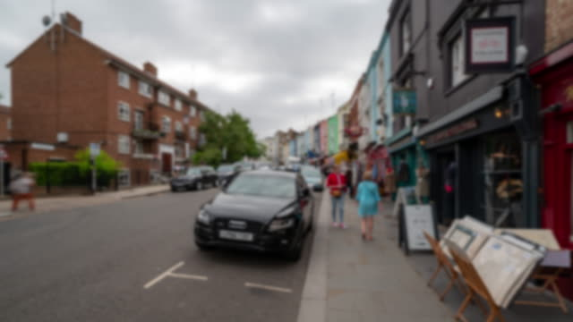Blurred background Time-lapse: Pedestrian Crowd at Notting Hill flea market in west London England UK