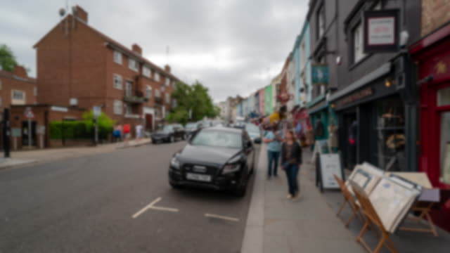blurred background time-lapse: pedestrian crowd at notting hill flea market in west london england uk - notting hill videos stock videos & royalty-free footage