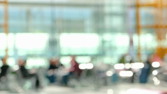 blurred background traveler with baggage waiting to departure at airport terminal with bokeh light,transportation concept - image focus technique stock videos & royalty-free footage