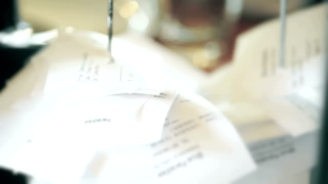 blurred bills with metal spike file. - receipt stock videos & royalty-free footage