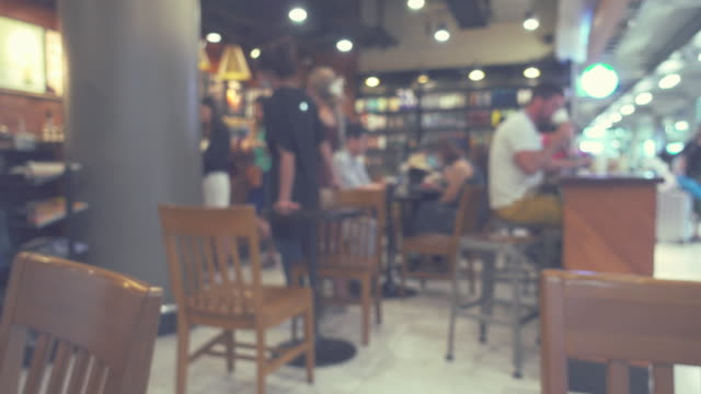 blurred bokeh; variety the people of lifestyles in modern restaurant. - cafe stock videos & royalty-free footage