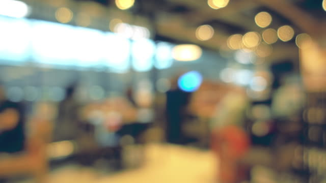 blurred bokeh; variety the people of lifestyles in modern restaurant. - defocussed stock videos & royalty-free footage