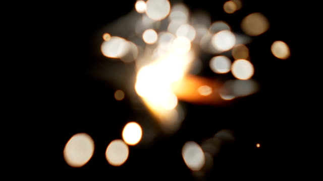 Blurred burning sparkler close up