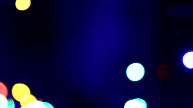 ぼかしのクリスマスの夜景を背景にしています。pal 、ntsc 、hd - アナモルフィック点の映像素材/bロール