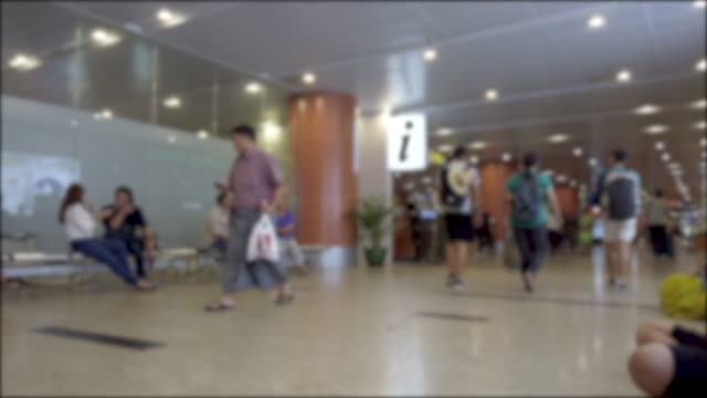 blurred crowd of people in airport passenger terminal - gate stock videos & royalty-free footage