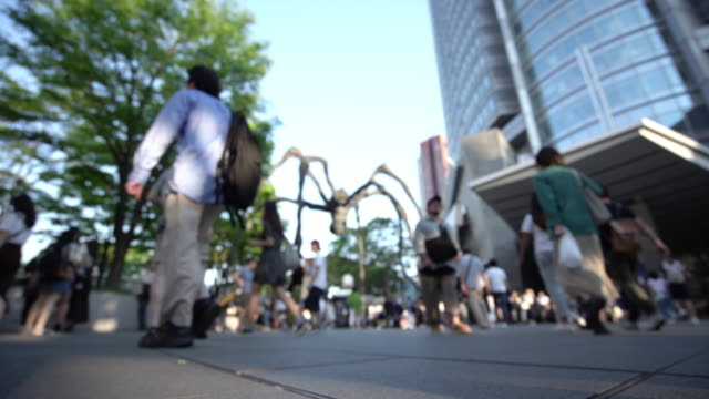 blurred crowd walking on roppongi hills, tokyo, japan. - roppongi hills stock videos and b-roll footage