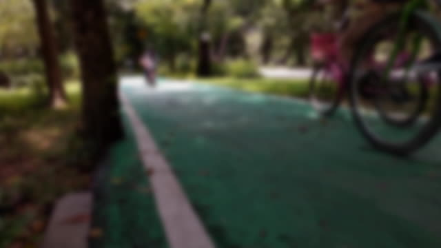 blurred cycling path in the park. - footpath stock videos & royalty-free footage
