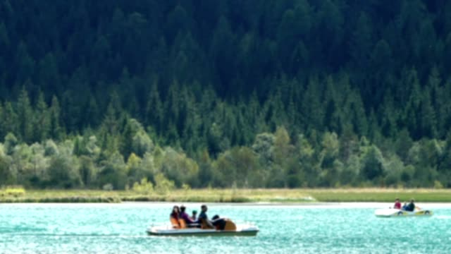 blurred family pedal the boat in lake dobbiaco - pedal boat stock videos and b-roll footage